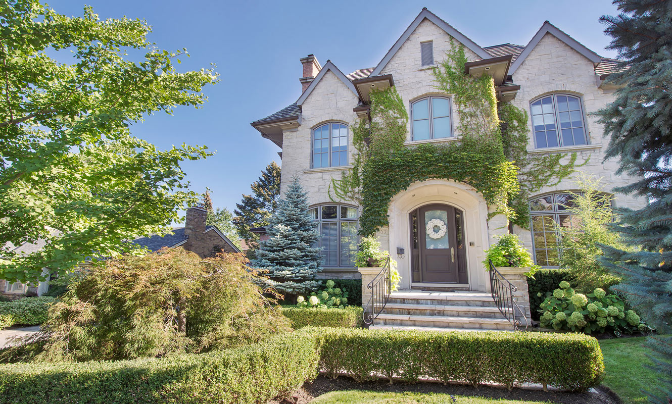 A stately luxury home in Lawrence Park with beautiful greenery.